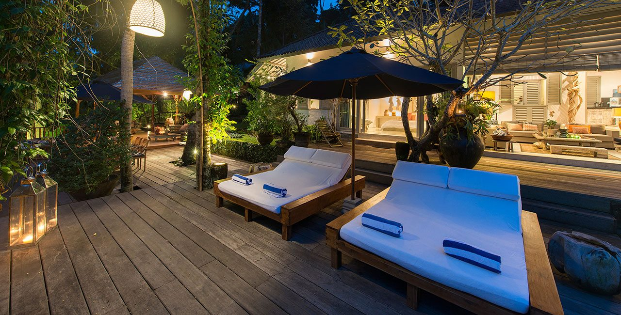 Pool Sun Loungers And Deck At Night